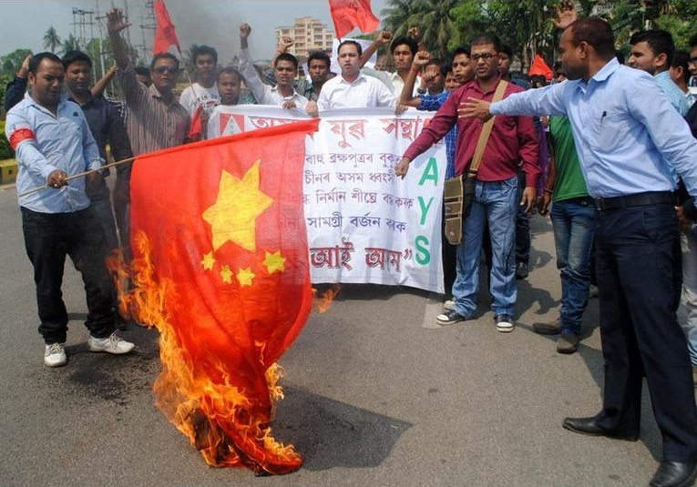 Indians burning a Chinese flag